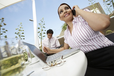 low blouse: Business woman and business man working outdoors