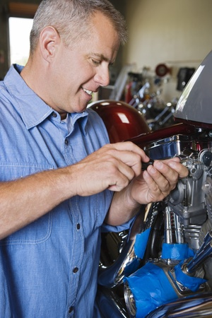 Mid-adult mechanic at work Stock Photo - 12592589