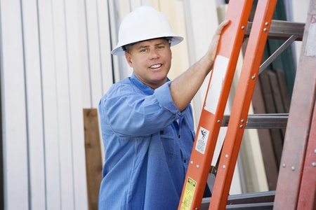 age 40 45 years: Workman Standing by a Ladder
