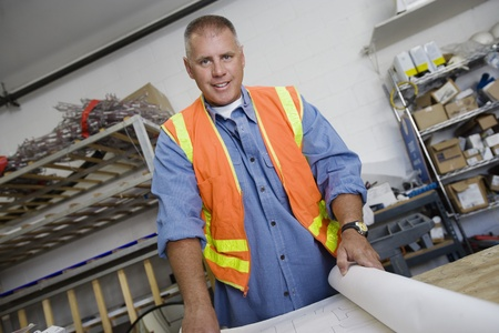 Workman Checking Building Plans Stock Photo - 12592617