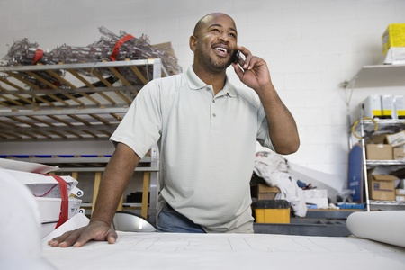 Workman Talking on Cell Phone Stock Photo - 12592620