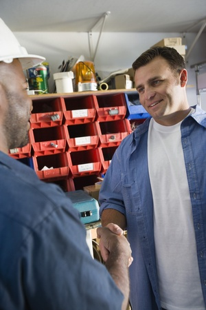 35 to 40 year olds: Workmen Shaking Hands