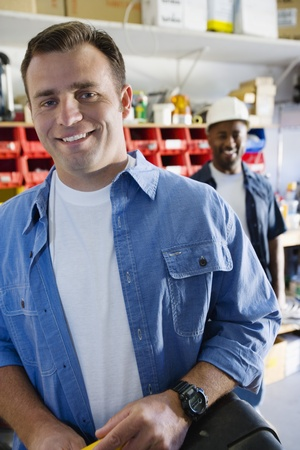 Workmen in a Shop Stock Photo - 12592625