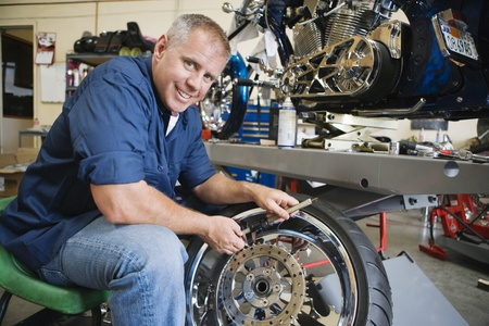 Mechanic Working on a Tire Stock Photo - 12592630