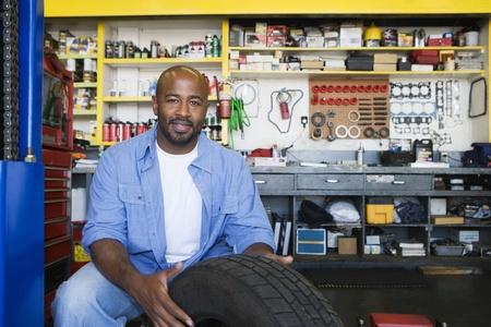 Auto Mechanic Working on a Tire Stock Photo - 12592635