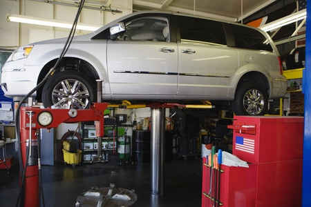 Minivan on a Lift in Shop Stock Photo - 12592639