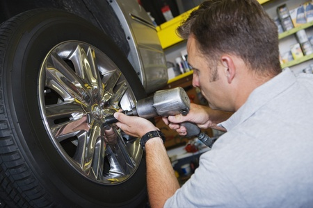 Mechanic Putting Tire on a Car Stock Photo - 12592641