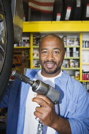 Auto Mechanic Working on a Tire Stock Photo - 12592642