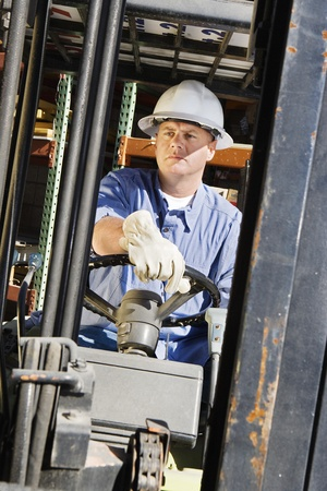 experienced operator: Man Driving a Forklift