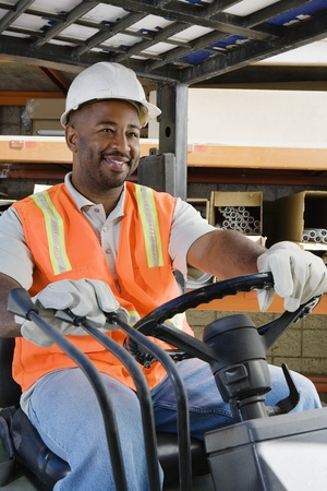 40 to 45 years old: Workman Driving a Forklift