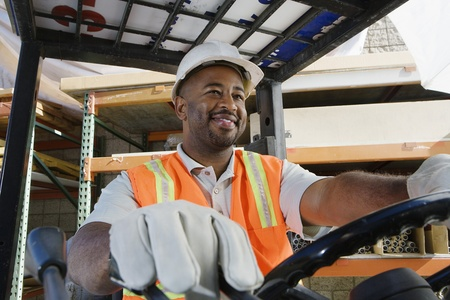 Worker Driving a Forklift Stock Photo - 12592647