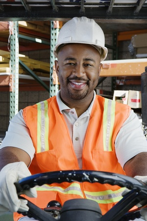 Man Driving a Forklift Stock Photo - 12592648