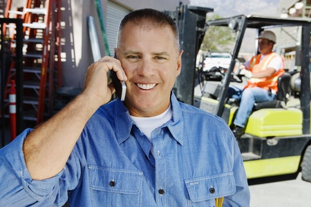 45 years old: Workman Talking on a Cell Phone LANG_EVOIMAGES