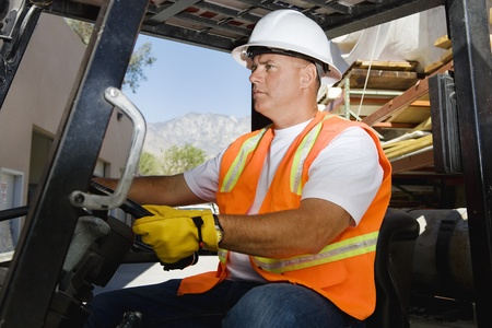 40 to 45 year olds: Worker Driving a Forklift