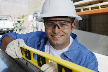 Workman Using a Spirit Level Stock Photo - 12592660