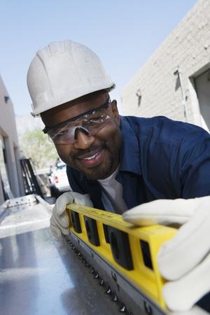 Workman Using a Level Stock Photo - 12592661