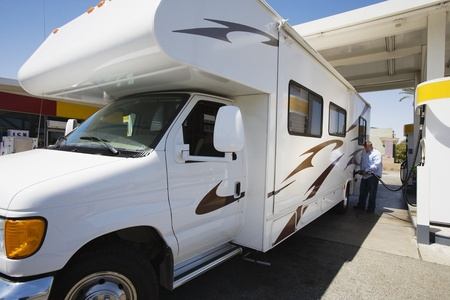 40 to 45 years old: Man Refueling RV
