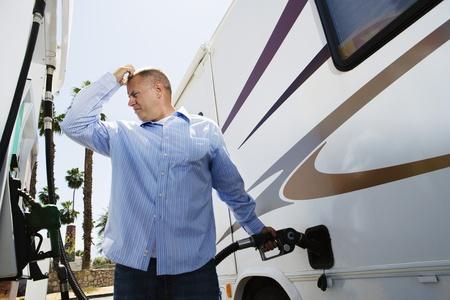 fuelling pump: Man Refueling RV