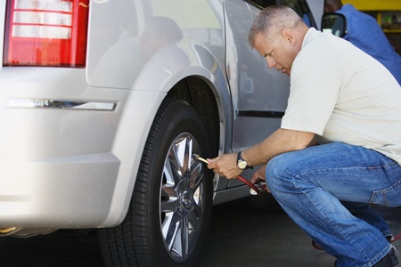 Man Filling Tires on RV Stock Photo - 12592666