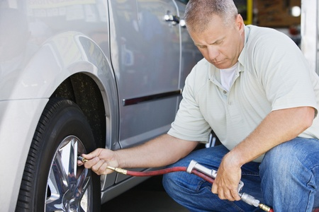 40 to 45 years old: Man Filling Tires on RV