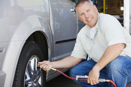 Man Filling Tires on RV Stock Photo - 12592668
