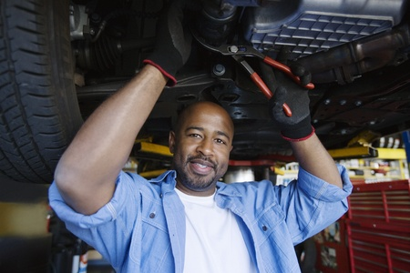 Auto Mechanic Beneath a Car Stock Photo - 12592672