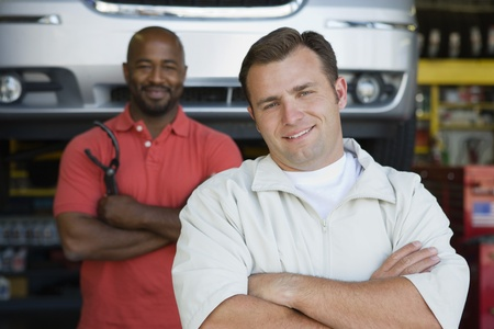 Two Men in an Auto Shop Stock Photo - 12592674