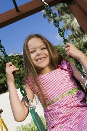 half length posed: Little Girl on a Swing