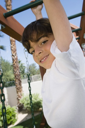 Little Boy on a Jungle Gym Stock Photo - 12592699
