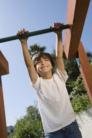 half length posed: Little Boy on a Jungle Gym