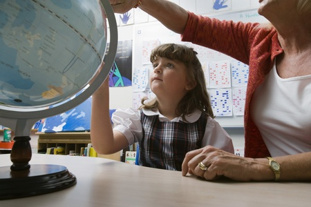 Little Girl Learning Geography Stock Photo - 12592703