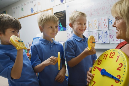 grade school age: Schoolboys Learning to Tell Time