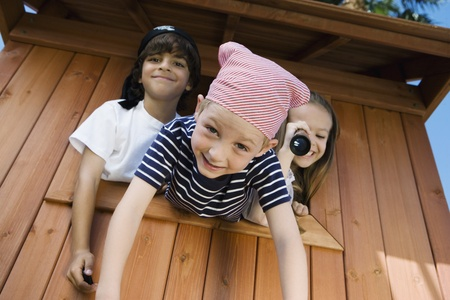 Kids Playing in Playhouse Stock Photo - 12592729