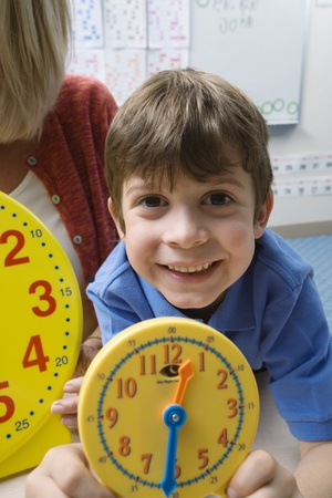 cropped out: Little Boy Learning to Tell Time