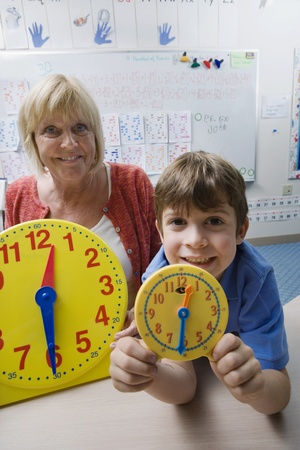 Little Boy Learning to Tell Time Stock Photo - 12592731