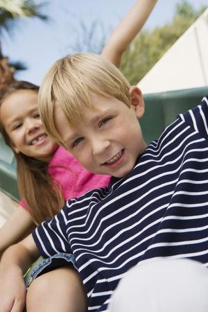 Little Kids on a Slide Stock Photo - 12592739