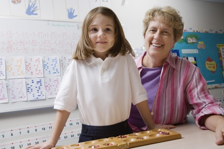 7 9 years: Teacher and Schoolgirl with Counting Tray
