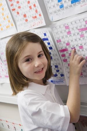 calendario escolar: Se�alando a la escuela un d�a en un horario