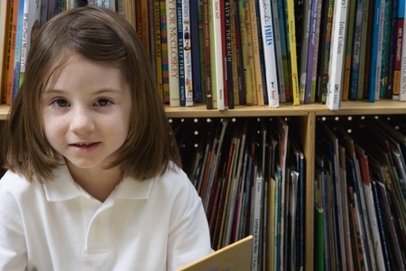 grade school age: Little Girl Reading in the Library