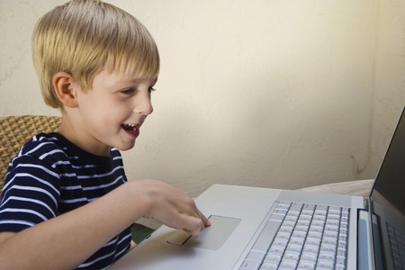 6 7 year old: Little Boy Using a Laptop
