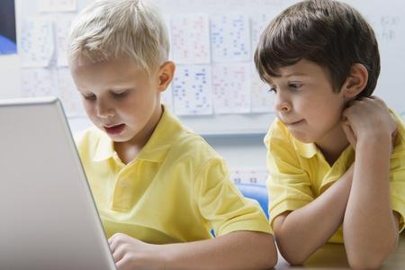 school room: Schoolboys Using a Laptop