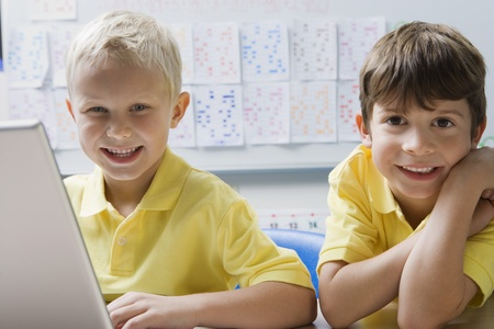 Schoolboys Using a Laptop Stock Photo - 12592761