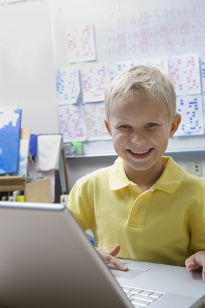 Schoolboy Using a Laptop Stock Photo - 12592762