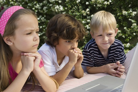Shocked Little Kids Looking at a Laptop Stock Photo - 12592778