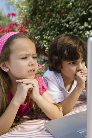 Little Kids Looking at a Laptop Stock Photo - 12592779