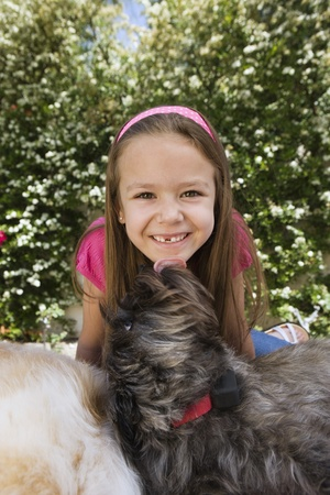 Dog Licking Little Girl's Chin Stock Photo - 12592789