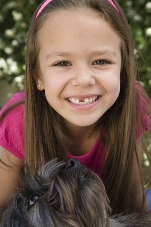 Dog Looking up at Little Girl Stock Photo - 12592790