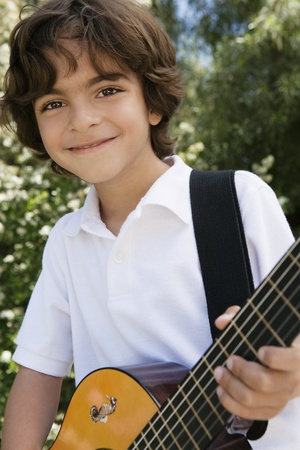 Little Boy Playing Guitar Stock Photo - 12592800