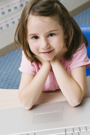 Little Girl Using a Laptop Stock Photo - 12592803