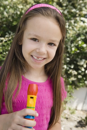 6 7 year old: Little Girl with a Recorder LANG_EVOIMAGES